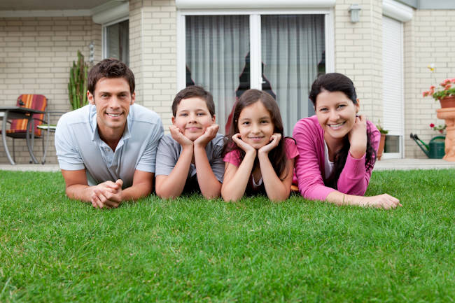 Family on lawn waiting for dead animals to removed from house